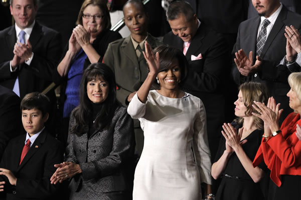 First lady Michelle Obama waves on Capitol Hill in Washington, Tuesday, Jan. 25, 2011, prior to the start of President Barack Obama's State of the Union address. (AP Photo/Charles Dharapak)