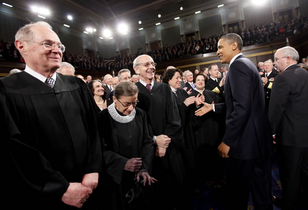 President Barack Obama greets Justice Sonia Sotomayor on Capitol Hill in Washington, Tuesday, Jan. 25, 2011, prior to delivering his State of the Union address. Justices, from left are, Anthony Kennedy, Ruth Bader Ginsburg, Stephen Breyer and Sotomayor. (AP Photo/Pablo Martinez Monsivais)