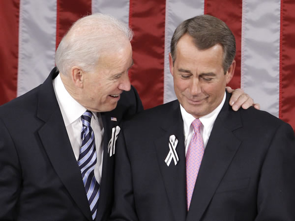 Vice President Joe Biden talks with House Speaker John Boehner of Ohio on Capitol Hill in Washington, Tuesday, Jan. 25,