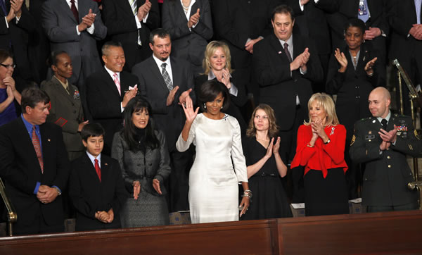 First lady Michelle Obama waves on Capitol Hill in Washington, Tuesday, Jan. 25, 2011, prior to the start of President Barack Obama's State of the Union address. (AP Photo/Evan Vucci)