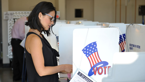 Actress Olivia Munn casts her election ballot at a polling place in Los Angeles on Tuesday Nov. 6, 2012. (Photo by John Shearer/Invision/AP)
