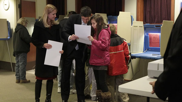 "<div class=""meta ""><span class=""caption-text "">Republican vice presidential candidate, Rep. Paul Ryan, R-Wis., shows his ballot to his daughter Liza as his wife Janna looks on at left, while voting at the Hedberg Public Library in Janesville, Wis., Tuesday, Nov. 6, 2012. (AP Photo/Mary Altaffer)</span></div>"
