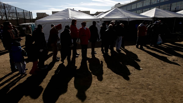 Voters wait in line to cast their ballots under a tent at a consolidated polling station for residents of the Rockaways on Election Day, Tuesday, Nov. 6, 2012, in the Queens borough of New York. Voting in a the U.S. presidential election was the latest challenge for the hundreds of thousands of people in the New York-New Jersey area still affected by Superstorm Sandy, as they struggled to get to non-damaged polling places to cast their ballots in one of the tightest elections in recent history. (AP Photo/Jason DeCrow)