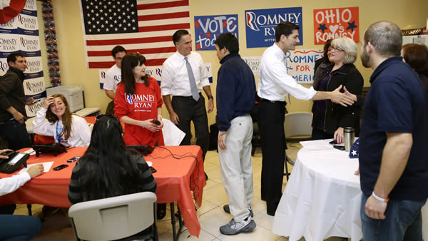"<div class=""meta ""><span class=""caption-text "">Republican presidential candidate, former Massachusetts Gov. Mitt Romney and his vice presidential running mate, Rep. Paul Ryan, R-Wis., greet campaign workers at a call center in Richmond Heights, Ohio, on Election Day, Tuesday, Nov. 6, 2012. (AP Photo/Charles Dharapak)</span></div>"