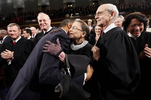 President Barack Obama hugs Justice Ruth Bader Ginsburg on Capitol Hill in Washington, Tuesday, Jan. 25, 2011, prior to delivering his State of the Union address. From left are, Chief Justice John Roberts, Justice Anthony Kennedy, Obama, Justice Ginsburg and Justice Stephen Breyer. (AP Photo/Pablo Martinez Monsivais, Pool)