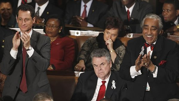 Rep. Anthony Weiner, D-N.Y., left, and Rep. Charles Rangel, D-N.Y., right stand and applaud as Rep. Peter King, R-N.Y. sits during President Barack Obama's State of the Union address in Washington, Tuesday, Jan. 25, 2011. (AP Photo/Evan Vucci)