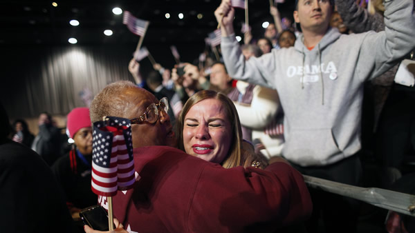 "<div class=""meta ""><span class=""caption-text "">Supporters of President Barack Obama react to favorable media projections at the McCormick Place during an election night watch party in Chicago on Tuesday, Nov. 6, 2012. (AP Photo/Jerome Delay)</span></div>"