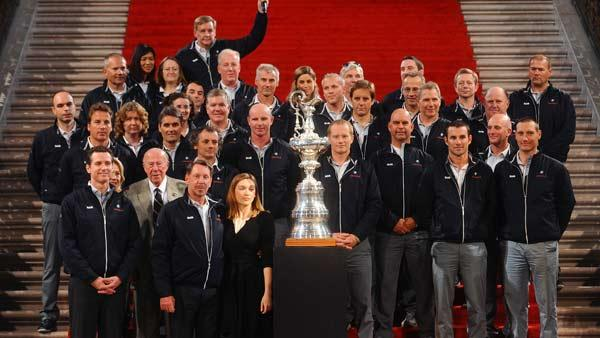 Members of BMW Oracle Racing and dignitaries stand with the America's Cup during a homecoming ceremony at SF City Hall.