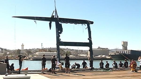 Oracle team's capsized yacht brought out of water