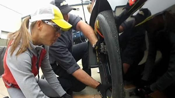 Woman breaks new ground in pit crew