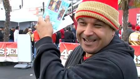 Excited 49er fan holds up Super Bowl tickets