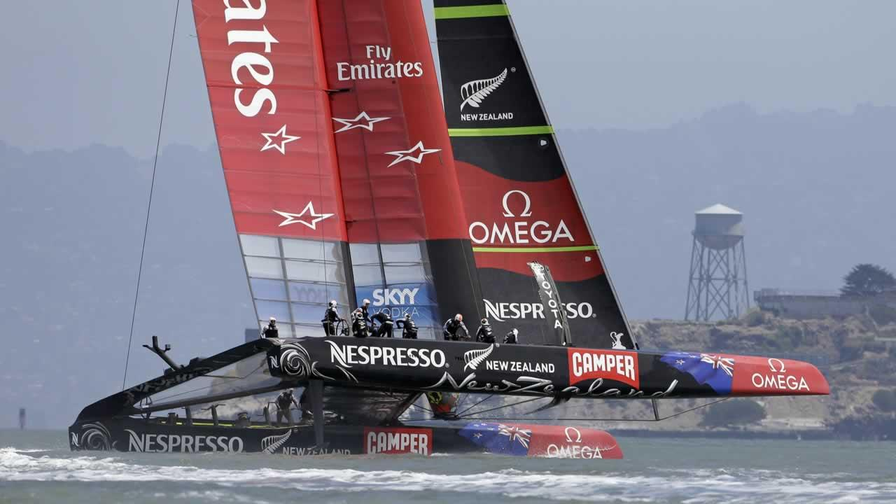 Emirates Team New Zealand races alone past Alcatraz Island during an Americas Cup challenger series sailing race Sunday, July 7, 2013, in San Francisco.