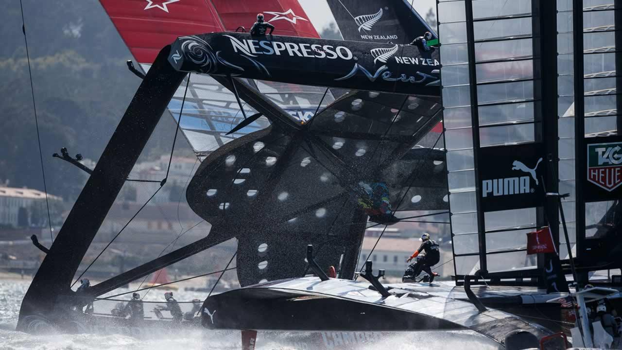 In this photo provided by the Americas Cup Event Authority, Emirates Team New Zealand, left, nearly capsizes alongside Oracle Team USA, right,
