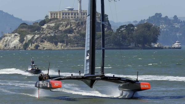 Oracle Team USA sails past Alcatraz Island after the 13th race of the America's Cup sailing event against Emirates Team New Zealand was canceled due to excessive wind.