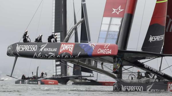 Emirates Team New Zealand, foreground, leads Oracle Team USA heading to the leeward marks during the first running of the 13th race of the America's Cup sailing event, Friday, Sept. 20, 2013, in San Francisco.