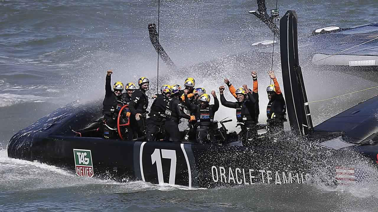 The crew on Oracle Team USA celebrates after winning the 19th race against Emirates Team New Zealand to win the Americas Cup sailing event, Wednesday, Sept. 25, 2013, in San Francisco. (AP Photo/Marcio Jose Sanchez)