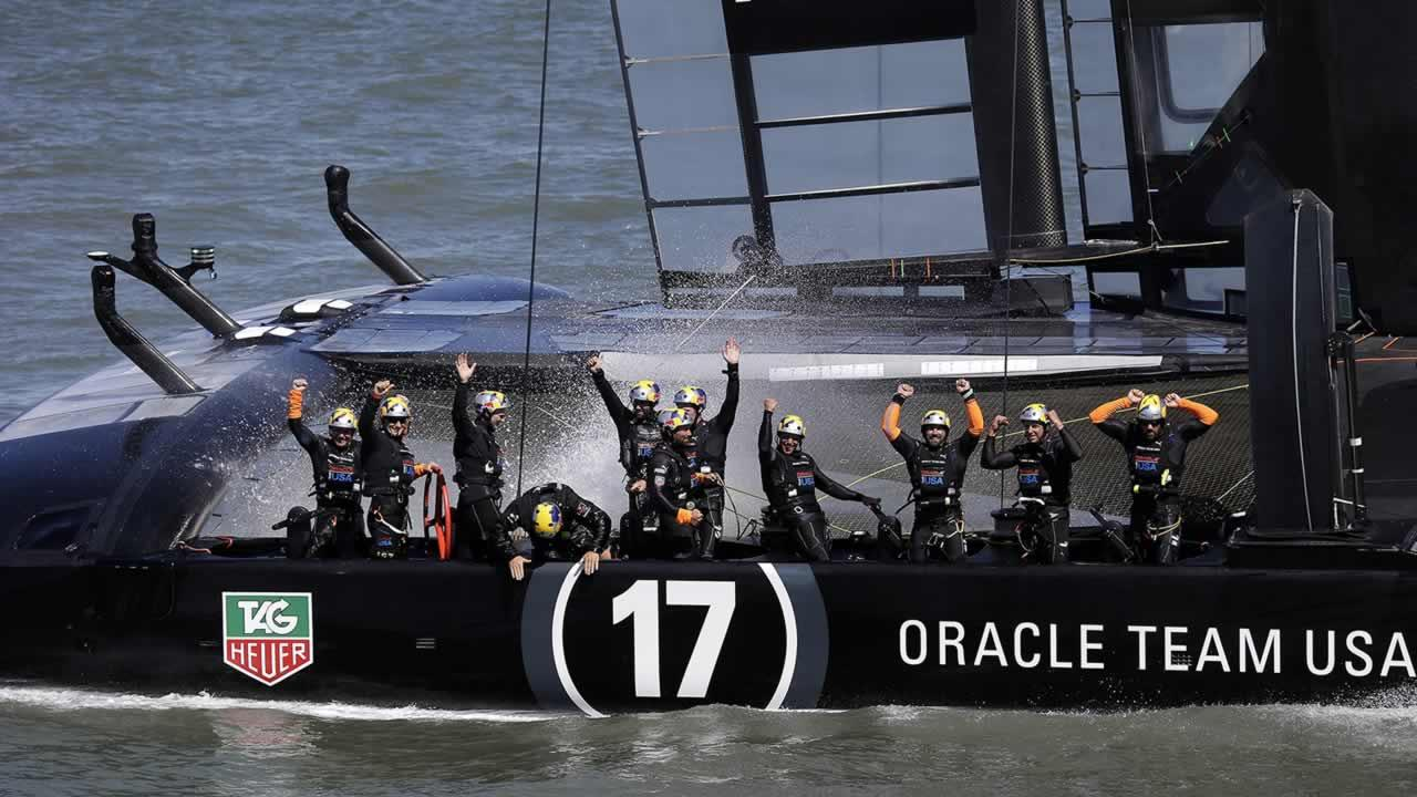 Oracle Team USA crew celebrates after winning the 19th race against Emirates Team New Zealand to win the Americas Cup sailing event Wednesday, Sept. 25, 2013, in San Francisco. (AP Photo/Marcio Sanchez)