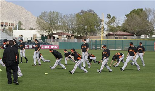 San Francisco Giants stretch during a spring training baseball workout Sunday, Feb. 19, 2012, in Scottsdale, Ariz. <span class=meta>(AP Photo&#47;Darron Cummings)</span>