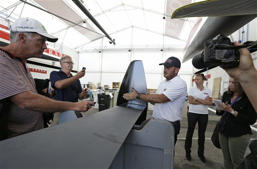 Luna Rossa Challenge skipper Max Sirena shows off the latest rudder being used on their catamaran at the Italian team&#39;s America&#39;s Cup training base Tuesday, July 2, 2013 in San Francisco. <span class=meta>(AP Photo&#47;Eric Risberg)</span>