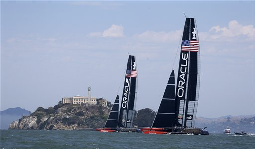A pair of Oracle Team USA catamarans sail past Alcatraz Island during training for the America&#39;s Cup Wednesday, July 3, 2013 in San Francisco. Opening ceremonies for the sailing event are on Thursday. <span class=meta>(AP Photo&#47;Eric Risberg)</span>