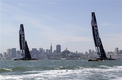 A pair of Oracle Team USA catamarans sails past the skyline during training for the America&#39;s Cup Wednesday, July 3, 2013 in San Francisco. Opening ceremonies for the sailing event are on Thursday. <span class=meta>(AP Photo&#47;Eric Risberg)</span>