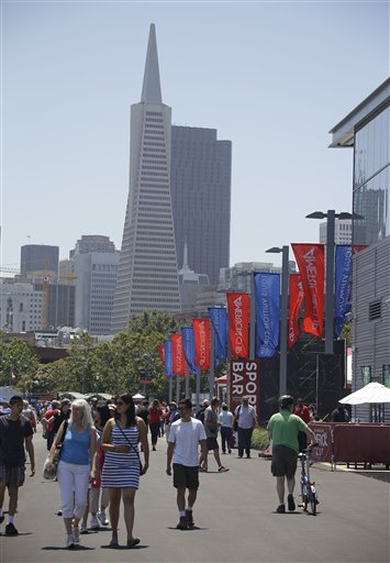 People walk through the America&#39;s Cup Park before opening ceremonies of the sailing event Thursday, July 4, 2013 in San Francisco. <span class=meta>(AP Photo&#47;Eric Risberg)</span>