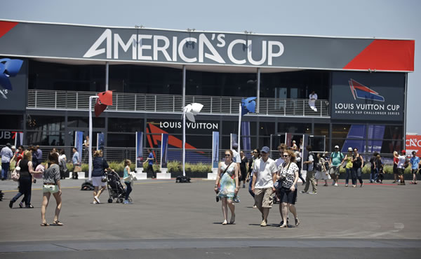 People walk through the America&#39;s Cup Park before opening ceremonies of the sailing event Thursday, July 4, 2013, in San Francisco. The first race in the challenger series is on Sunday. <span class=meta>(AP Photo&#47;Eric Risberg)</span>