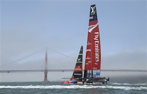 Emirates Team New Zealand makes its way past the Golden Gate Bridge in the fog during America&#39;s Cup training Tuesday, July 2, 2013, in San Francisco. Opening ceremonies for the sailing event are on Thursday. <span class=meta>(AP Photo&#47;Eric Risberg)</span>
