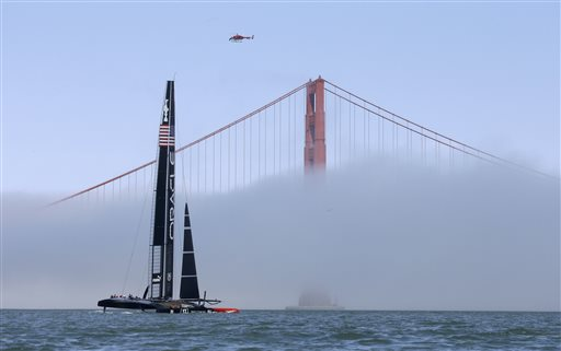 An Oracle Team USA catamaran makes its way past the Golden Gate Bridge in the fog during training for the America&#39;s Cup, Wednesday, July 3, 2013, in San Francisco. Opening ceremonies for the sailing event are scheduled for Thursday. <span class=meta>(AP Photo&#47;Eric Risberg)</span>