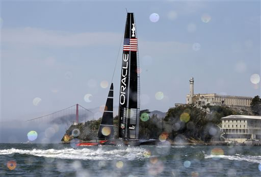 An Oracle Team USA catamaran sails past Alcatraz Island with the Golden Gate Bridge in the background during training for the America&#39;s Cup, Wednesday, July 3, 2013, in San Francisco. Opening ceremonies for the sailing event are scheduled for Thursday. <span class=meta>(AP Photo&#47;Eric Risberg)</span>