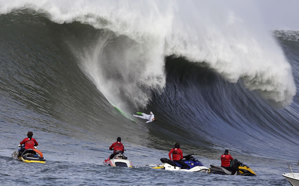 Nic Lamb goes tumbling into a wave during the third heat of the first round of the Mavericks Invitational big wave surf contest Friday, Jan. 24, 2014, in Half Moon Bay, Calif. (AP Photo/Eric Risberg)