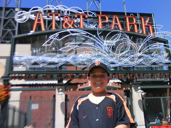 Giants fan Alex P. from Fremont  in front of AT&T Park.  (Photo submitted by Sandy N. via uReport)