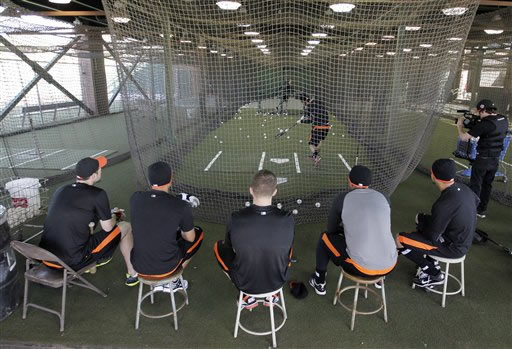 San Francisco Giants&#39; Brandon Crawford takes batting practice as teammates watch during spring training baseball, Saturday, Feb. 18, 2012 in Scottsdale, Ariz. The pitchers and catchers first official practice for the Giants is Sunday. <span class=meta>(AP Photo&#47;Darron Cummings)</span>