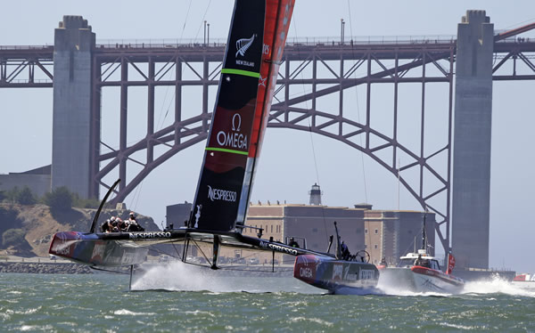 Emirates Team New Zealand makes its way past Fort Point and the Golden Gate Bridge during training for the America's Cup sailing event on Thursday, Sept. 5, 2013, in San Francisco. The first races between Oracle Team USA and Emirates Team New Zealand are on Saturday. (AP Photo/Eric Risberg)