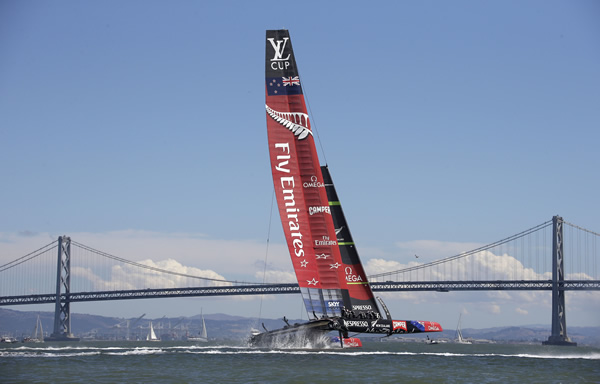 Emirates Team New Zealand goes past the finish line to win the eighth race of their America's Cup challenger series final sailing event against Luna Rossa Challenge Sunday, Aug. 25, 2013, in San Francisco. Emirates Team New Zealand won the race and series and will compete against Oracle Team USA next month. In the background is the San Francisco-Oakland Bay Bridge. (AP Photo/Eric Risberg)