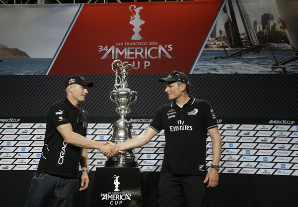 "<div class=""meta ""><span class=""caption-text "">Jimmy Spithill, left, skipper of Oracle Team USA and Dean Barker, right, skipper of Emirates Team New Zealand shake hands while posing with the America's Cup trophy following a news conference Thursday, Sept. 5, 2013, in San Francisco. The first races between Oracle Team USA and Emirates Team New Zealand are on Saturday. (AP Photo/Eric Risberg)</span></div>"
