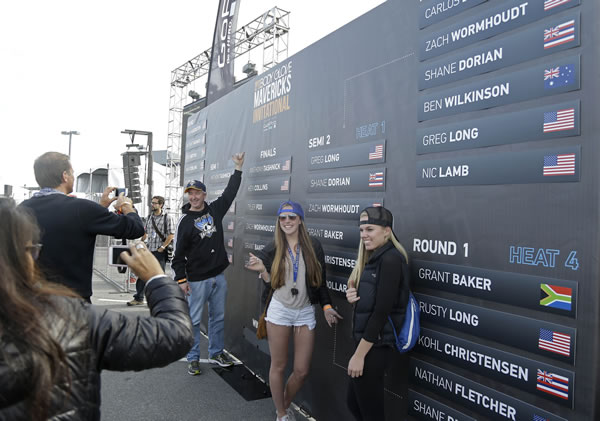 "<div class=""meta ""><span class=""caption-text "">Spectators pose by the leaderboard of the Mavericks Invitational big wave surf contest at a festival grounds where fans could watch the event Friday, Jan. 24, 2014, in Half Moon Bay, Calif. (AP Photo/Eric Risberg)</span></div>"