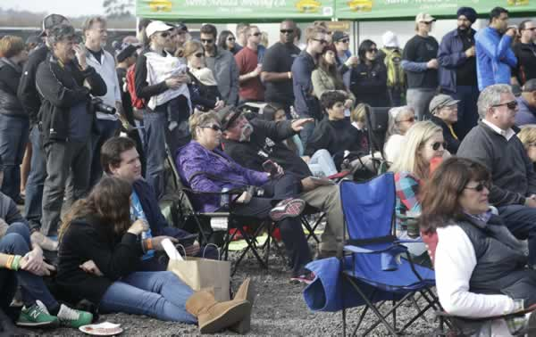 "<div class=""meta ""><span class=""caption-text "">Spectators watch the semifinals of the Mavericks Invitational big wave surf contest on a big scene at a festival area Friday, Jan. 24, 2014, in Half Moon Bay, Calif. (AP Photo/Eric Risberg)</span></div>"