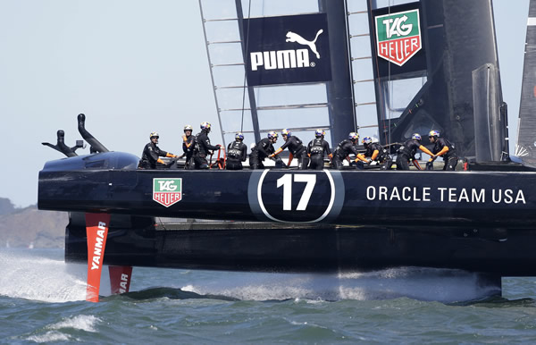 Jimmy Spithill skippers Oracle Team USA during training for the America's Cup sailing event Thursday, Sept. 5, 2013, in San Francisco. The first races between Oracle Team USA and Emirates Team New Zealand are on Saturday. (AP Photo/Eric Risberg)