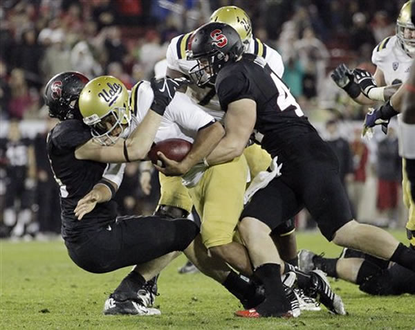 "<div class=""meta ""><span class=""caption-text "">UCLA quarterback Brett Hundley, center, is sacked against Stanford during the second half of the Pac-12 championship NCAA college football game in Stanford, Calif., Friday, Nov. 30, 2012. (AP Photo/Tony Avelar)</span></div>"