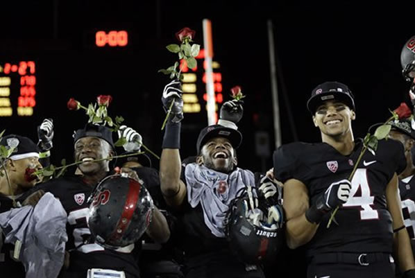 Stanford players celebrate after a 27-24 win over UCLA during the Pac-12 championship NCAA college football game in Stanford, Calif., Friday, Nov. 30, 2012. (AP Photo/Marcio Jose Sanchez)