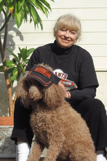 "<div class=""meta ""><span class=""caption-text "">Lucy Ball (poodle) and her human, Karen Morss, Redwood City, CA Congratulations to our San Francisco Giants! (Sent via uReport)</span></div>"