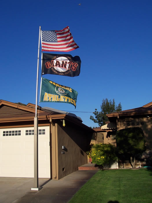 "<div class=""meta ""><span class=""caption-text "">Flags flying at a Hayward home. (Photo submitted by Lazyboy300) (KGO)</span></div>"