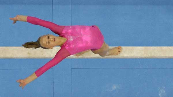 U.S. gymnast Nastia Liukin performs on the balance beam during the womens gymnastics individual all-around finals at the Beijing 2008 Olympics in Beijing, Friday, Aug. 15, 2008. (AP Photo/Rob Carr)