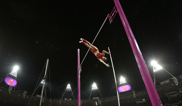"<div class=""meta ""><span class=""caption-text ""> Jennifer Suhr competes to win gold in the women's pole vault final during the athletics in the Olympic Stadium at the 2012 Summer Olympics, London, Monday, Aug. 6, 2012.  (AP Photo/Lee Jin-man)</span></div>"