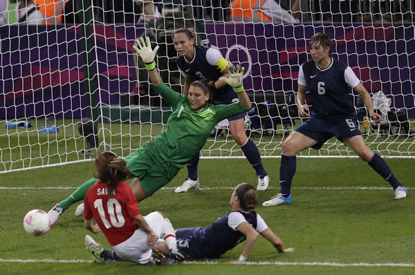 United States goalkeeper Hope Solo &#40;1&#41;makes a save against Japan during the women&#39;s soccer gold medal match at the 2012 Summer Olympics, Thursday, Aug. 9, 2012, in London. <span class=meta>(AP Photo&#47;Andrew Medichini)</span>