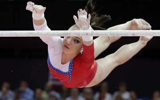 "<div class=""meta image-caption""><div class=""origin-logo origin-image ""><span></span></div><span class=""caption-text"">Russian gymnast Aliya Mustafina performs on the uneven bars during the artistic gymnastics women's apparatus finals at the 2012 Summer Olympics, Monday, Aug. 6, 2012, in London.  (AP Photo/Julie Jacobson)</span></div>"