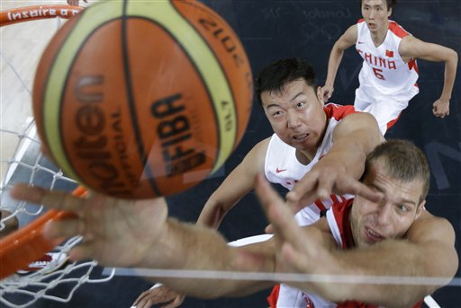 China&#39;s Wang Zhizhi, center, tries to block Russia&#39;s Sergey Monya on a drive to the basket at the 2012 Summer Olympics, Tuesday, July 31, 2012, in London. <span class=meta>(AP Photo&#47;Charles Krupa)</span>