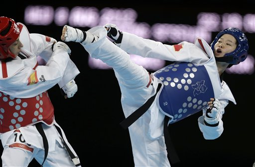 "<div class=""meta image-caption""><div class=""origin-logo origin-image ""><span></span></div><span class=""caption-text"">China's Wu Jingyu fights Spain's Brigette Yague Enrique (in red) during their gold medal match in women's 49-kg taekwondo competition at the 2012 Summer Olympics, Wednesday, Aug. 8, 2012, in London. (AP Photo/Ng Han Guan)</span></div>"