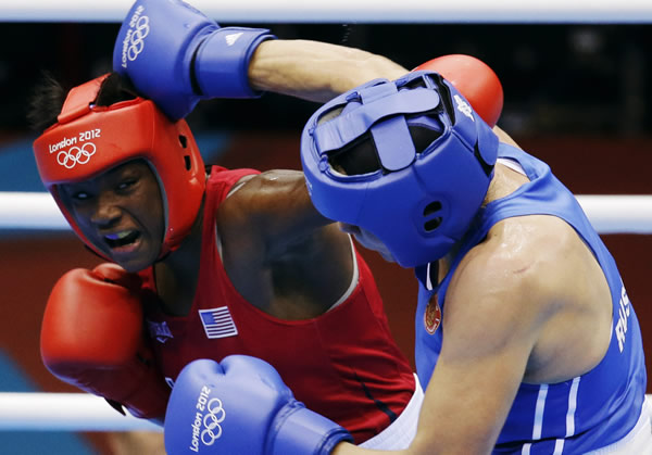"<div class=""meta ""><span class=""caption-text "">The United States' Claressa Shields, in red, fights Russia's Nadezda Torlopova, in blue, in a women's middleweight 75-kg boxing gold medal match at the 2012 Summer Olympics, Thursday, Aug. 9, 2012, in London. (AP Photo/Patrick Semansky)</span></div>"
